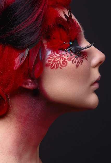 Young girl with red hair and creative ingenious makeup Premium Photo