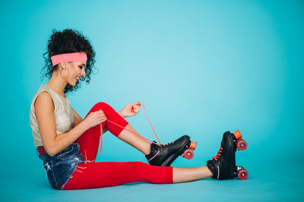 Young girl with roller skates isolated Free Photo