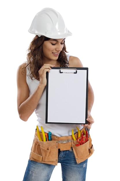 Young girl with tools for building and a empty poster Premium Photo