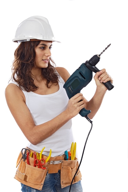Young girl with tools for building on a white background Premium Photo