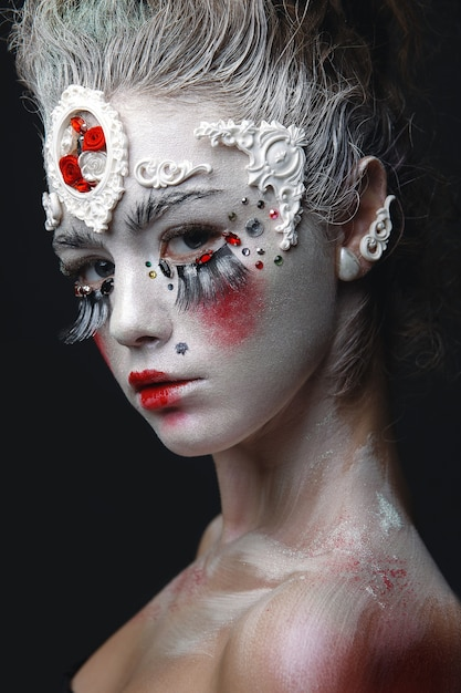 Young girl with a white hair and creative makeup Premium Photo