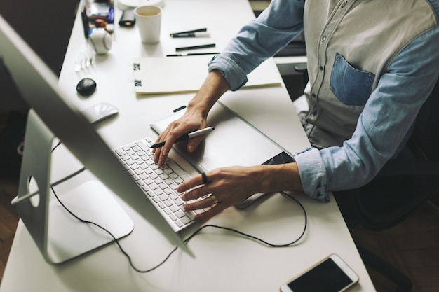 Young graphic designer working in office Free Photo