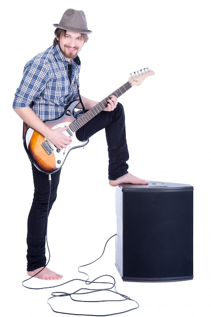 Young guitarist plays on the electric guitar. Premium Photo