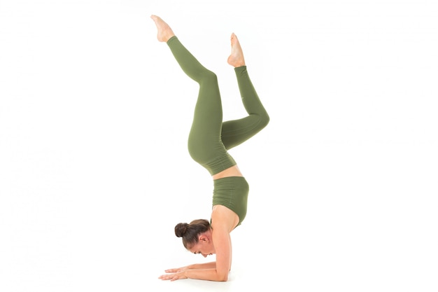 Young gymnast girl stretching and training Premium Photo