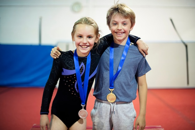 Young gymnasts with their medals Premium Photo