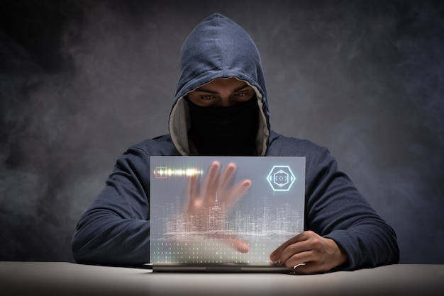Young hacker in data security concept Premium Photo