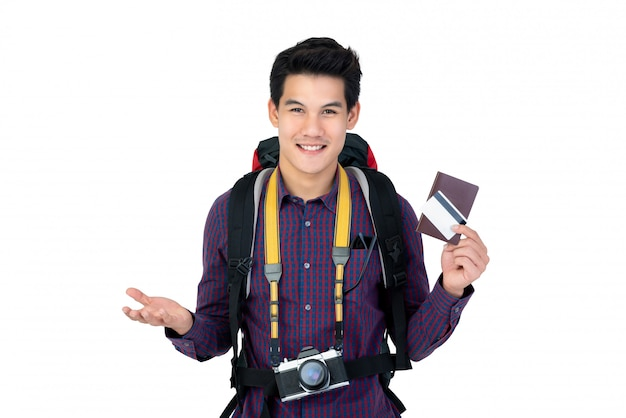 Young handsome asian man holding passport and credit card enjoyed having holidays Premium Photo