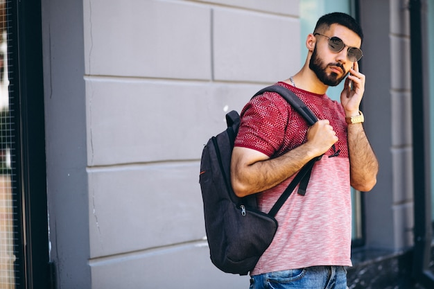 Young handsome bearded man student with phone Free Photo
