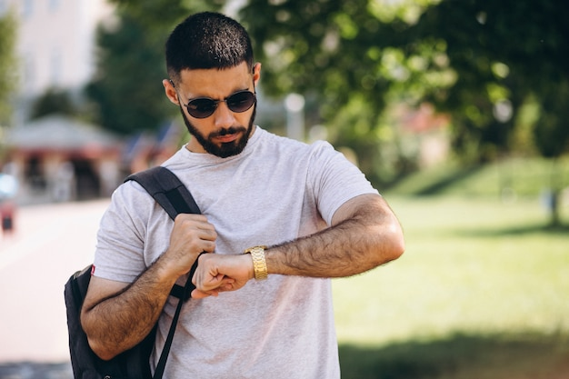 Young handsome bearded man student Free Photo