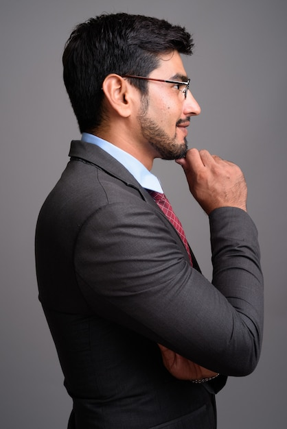 Young handsome bearded persian businessman wearing eyeglasses Premium Photo