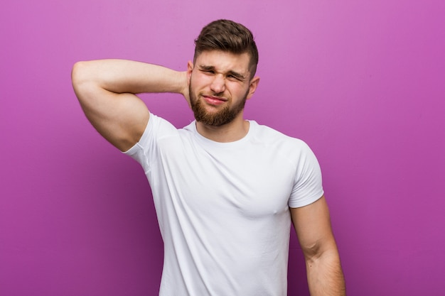 Young handsome caucasian man suffering neck pain due to sedentary lifestyle. Premium Photo