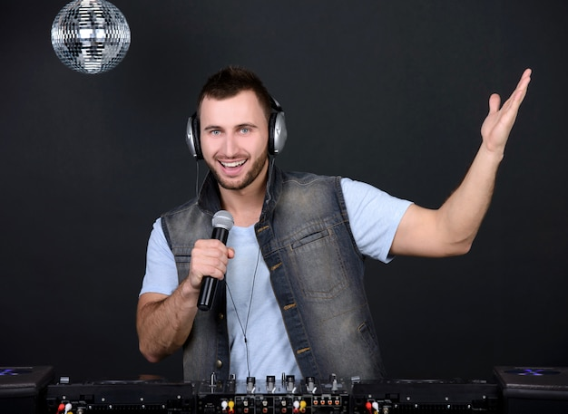 Young handsome deejay playing club music. Premium Photo