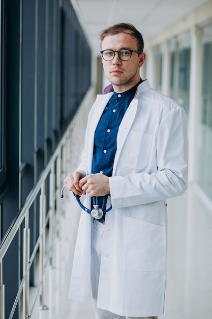 Young handsome doctor with stethoscope at clinic Free Photo