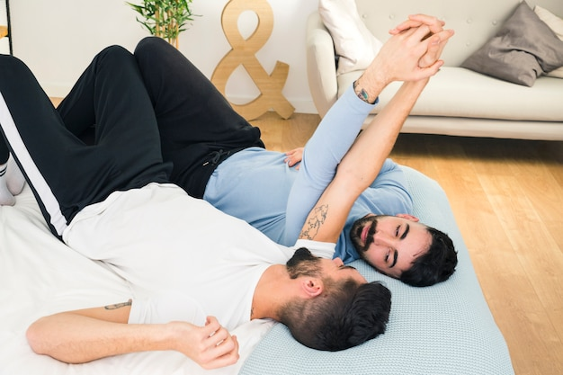 Free Photo   Young handsome gay couple lying on bed