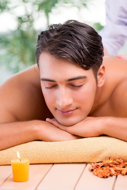 Young handsome man during spa procedure Premium Photo