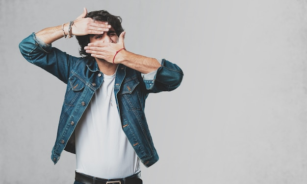 Young handsome man looking through a gap Premium Photo