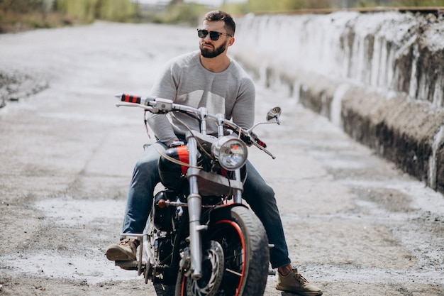 Young handsome man on motorcycle travelling Free Photo