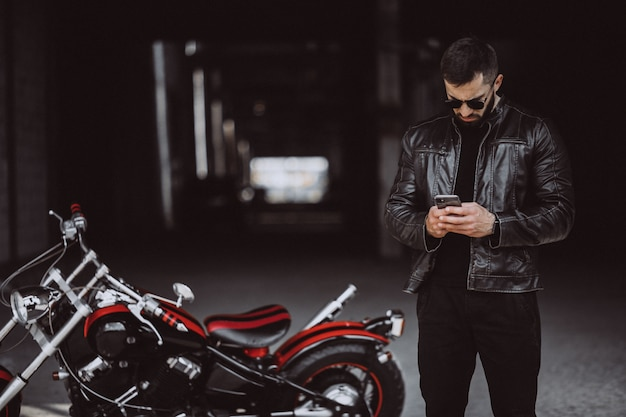 Young handsome man on motorcycle Free Photo