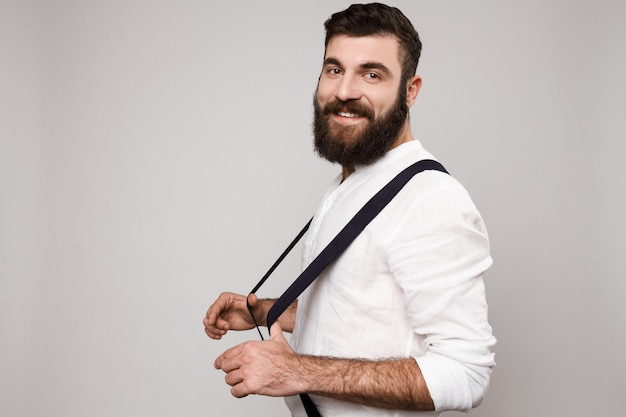 Young handsome man smiling posing over white. Free Photo