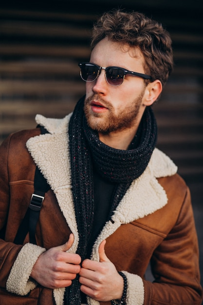 Young handsome man in a street outfit Free Photo