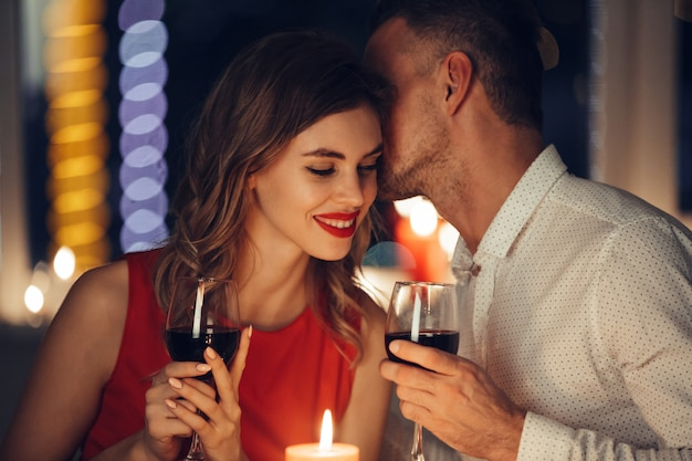 Young handsome man whisper to his woman while have romantic dinner Free Photo