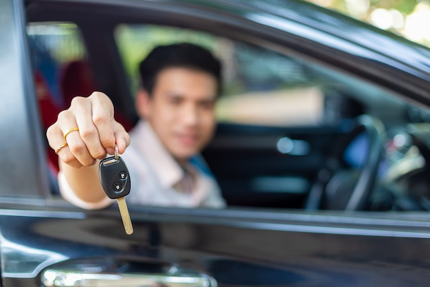 Young handsome man with car key remote Free Photo