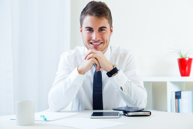 Young handsome man working in his office. Free Photo