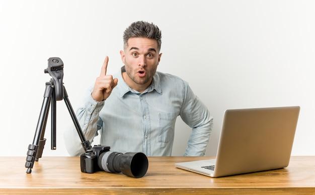 Young handsome photography teacher having an idea, inspiration concept. Premium Photo