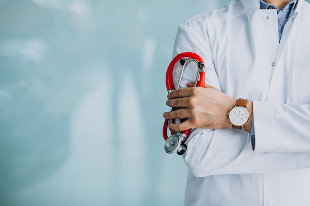 Young handsome physician in a medical robe with stethoscope Free Photo
