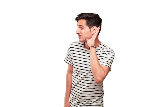 Young handsome tanned man paying attention, trying to hear and listen to what is being said, lending Premium Photo