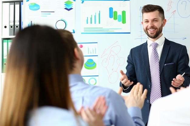Young handsome teacher man in suit with Premium Photo