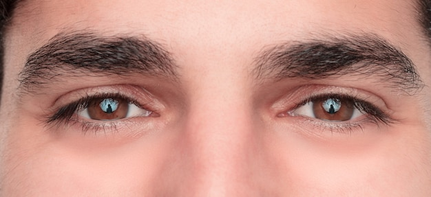 Young hansome and happy man eyes. close up Premium Photo