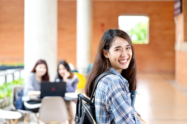 Young happy attractive asian student smiling to camera Premium Photo