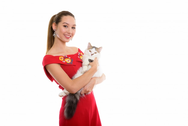 Young Happy Beautiful Asian Woman Smiling While Holding Cute Cat Premium Photo