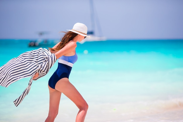 Young happy beautiful woman on summer vacation Premium Photo