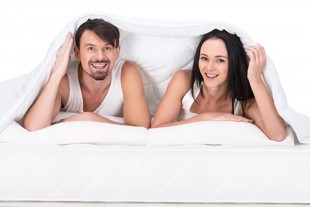 Young happy couple in a bed Premium Photo