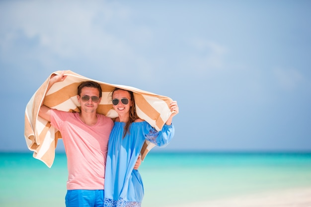 Young happy family during tropical beach vacation Premium Photo