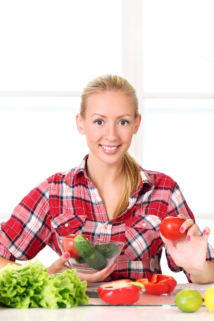 Young and happy girl preparing healthy food Free Photo
