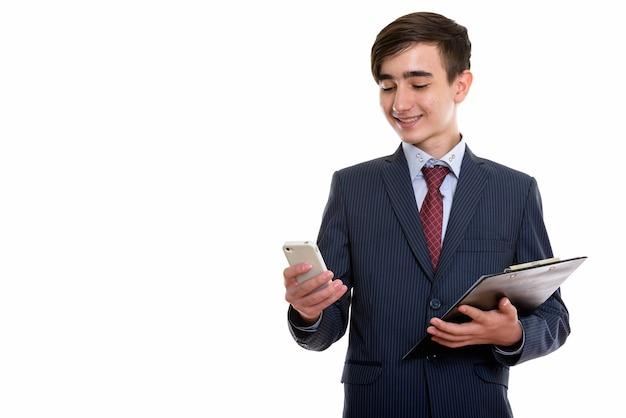 若い幸せなペルシャの10代の実業家 Premium写真