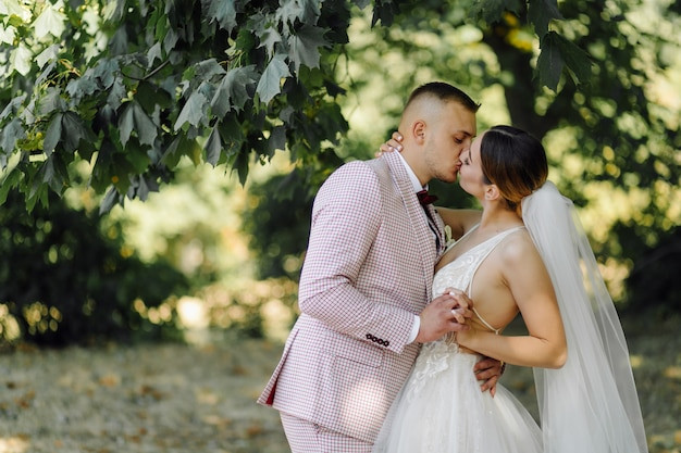 Young happy wedding couple. caucasian bride and groom embracing Free Photo
