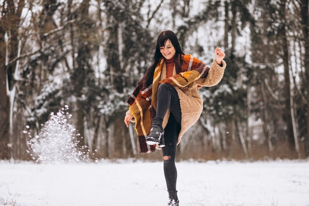 Young happy woman in warm cloths in a winter park Free Photo
