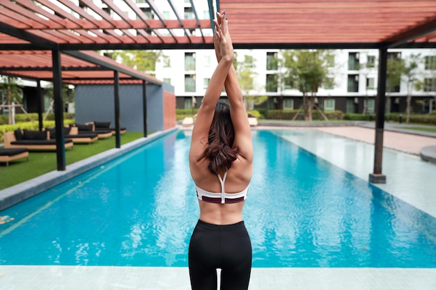 Young healthy and sporty woman do yoga stretching outdoor Premium Photo