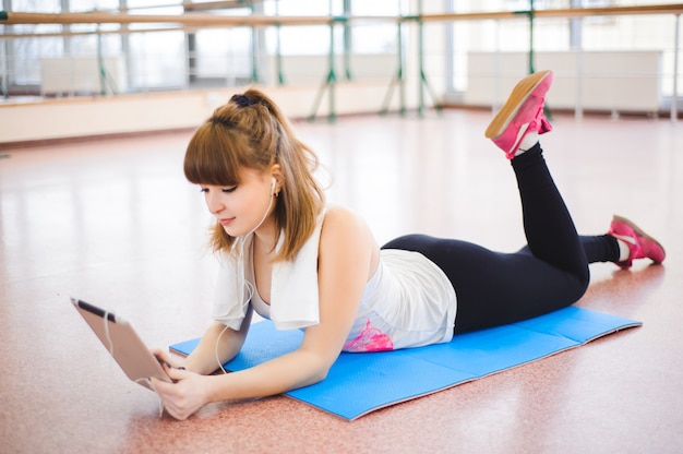 Young healthy woman take a rest in fitness Premium Photo