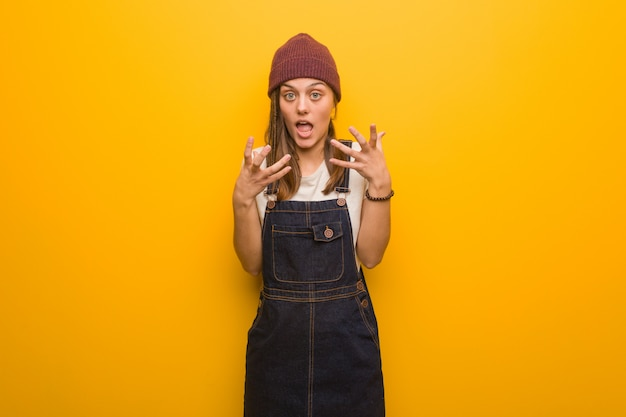 Young hipster woman angry and upset Premium Photo