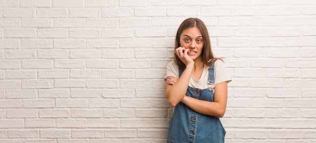 Young hipster woman biting nails, nervous and very anxious Premium Photo