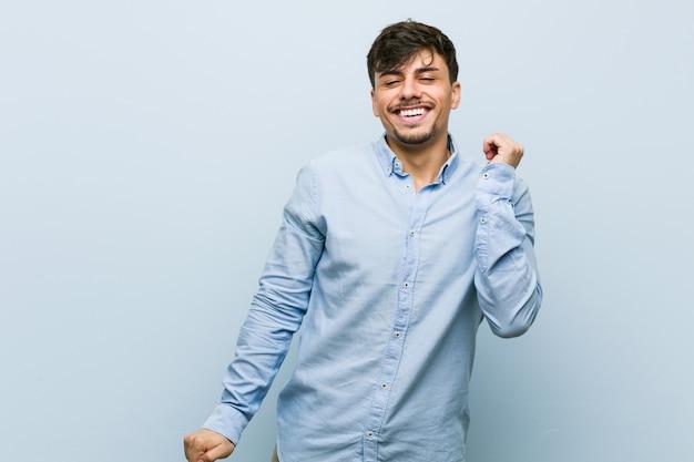 Young hispanic business man dancing and having fun. Premium Photo