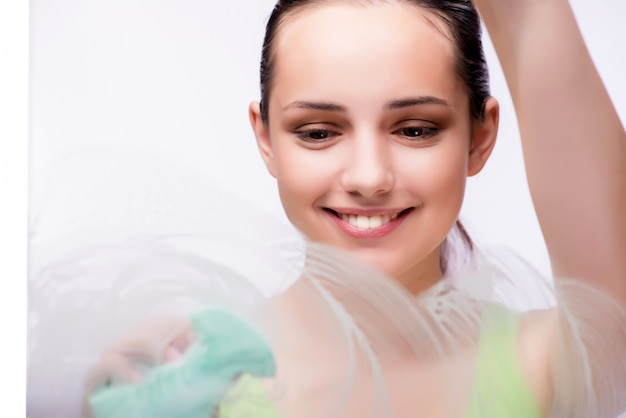 Young housewife in cleaning concept Premium Photo