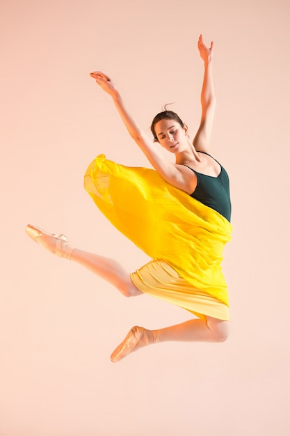 Young and incredibly beautiful ballerina is dancing at studio Free Photo