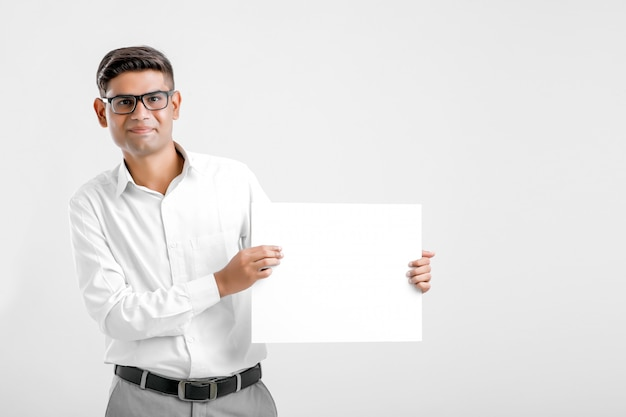 Young indian business executive showing blank sign board over white background Premium Photo