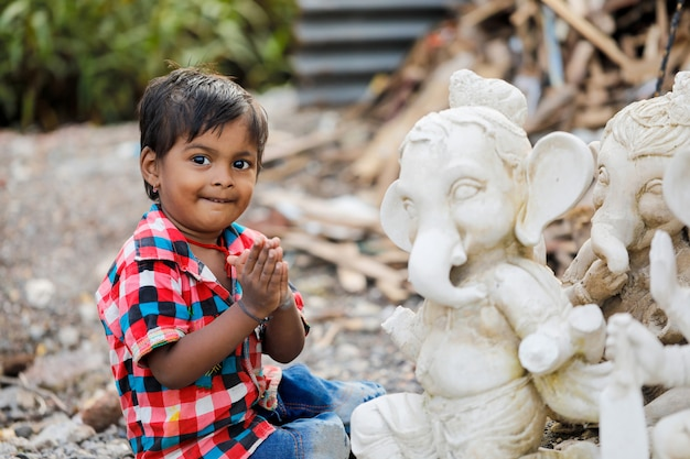 Young indian child with lord ganesha Premium Photo